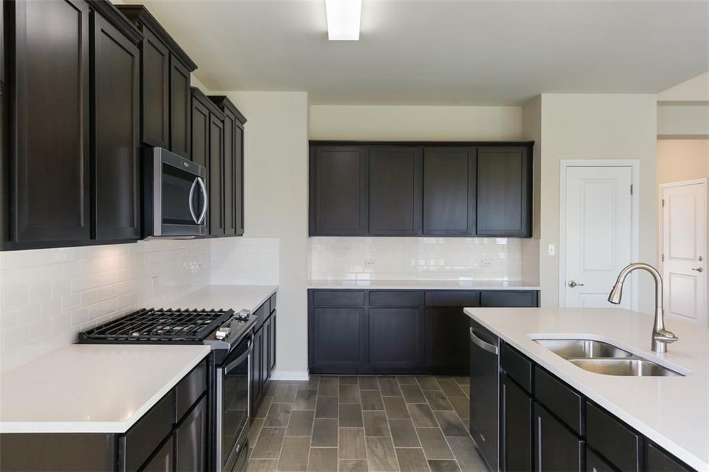 Kitchen-in-Pacesetter - Dormer-at-Pecan Park-in-Bastrop