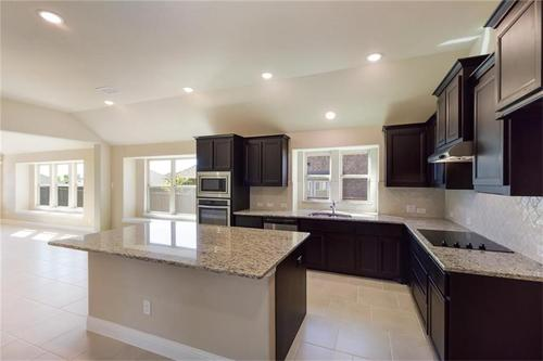 Kitchen-in-Pacesetter - Spicewood-at-Woodridge-in-Oak Point