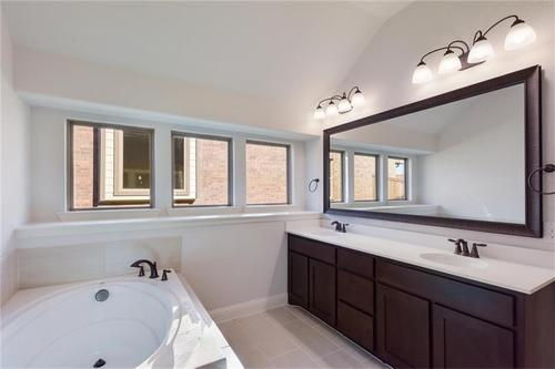 Bathroom-in-Pacesetter - Sandstone I-at-Woodridge-in-Oak Point