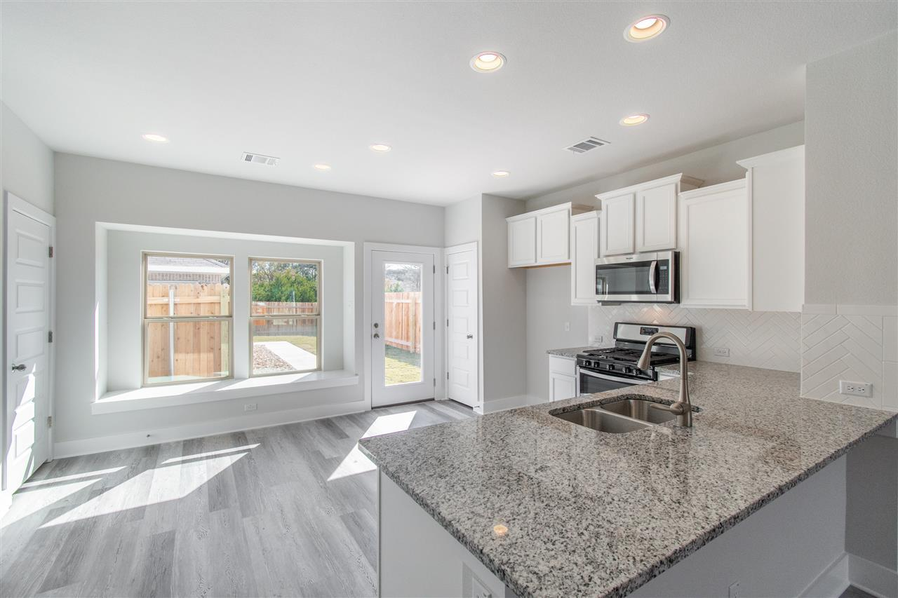 Kitchen featured in The Montgomery By Pacesetter Homes Texas in Austin, TX
