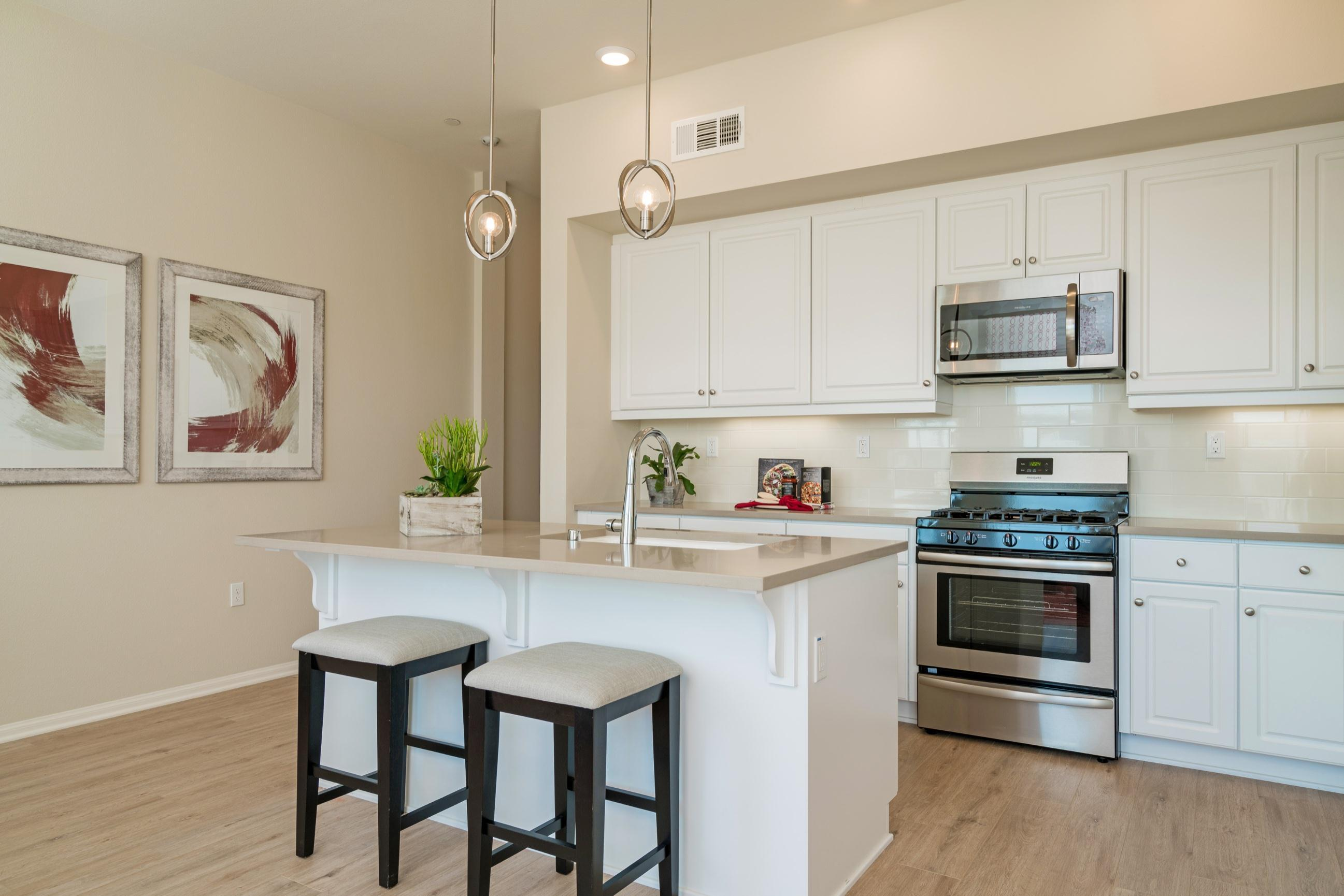 Kitchen featured in the Plan 1 By Heritage Building & Dev't in San Diego, CA