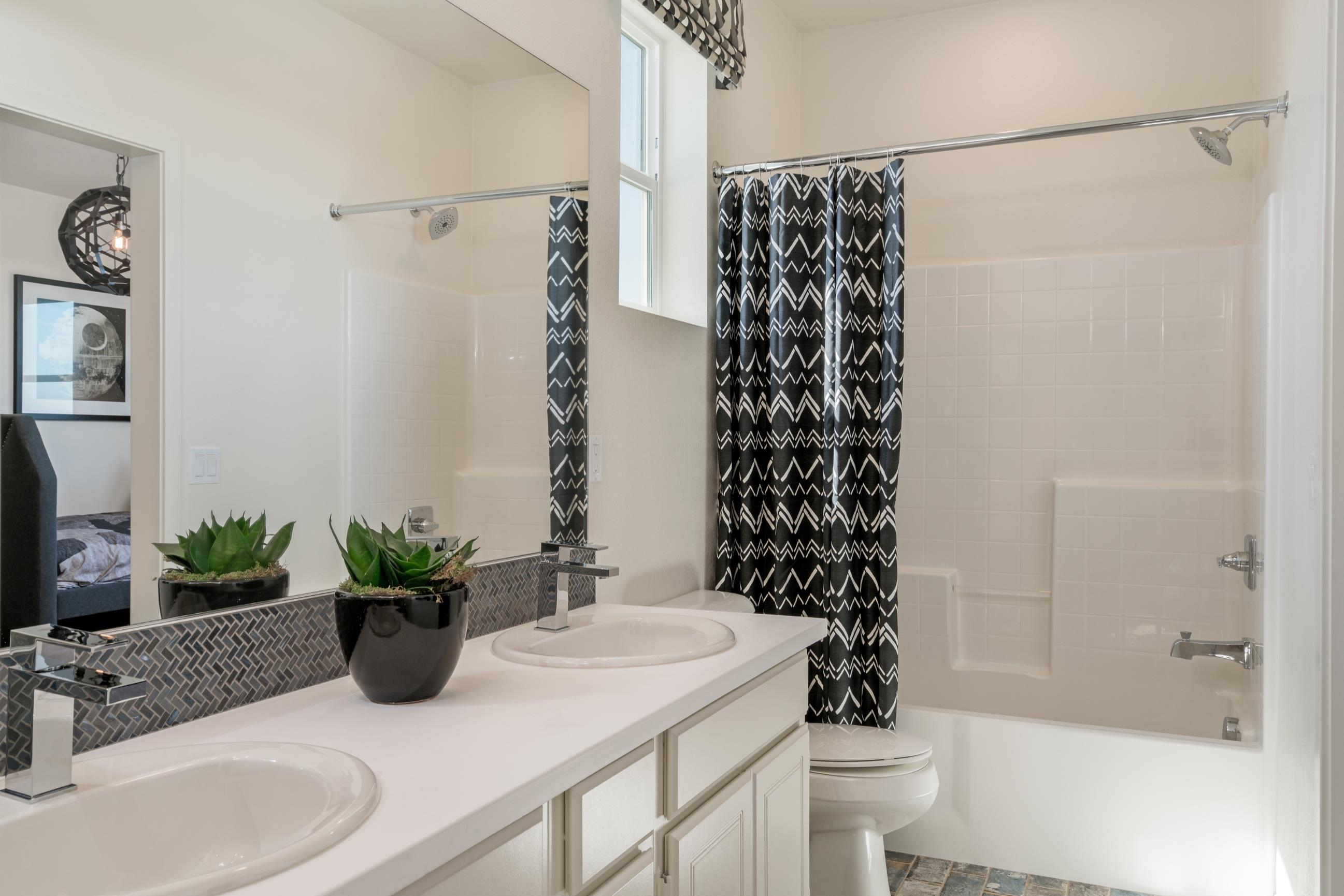 Bathroom featured in the Plan 6 By Heritage Building & Dev't in San Diego, CA