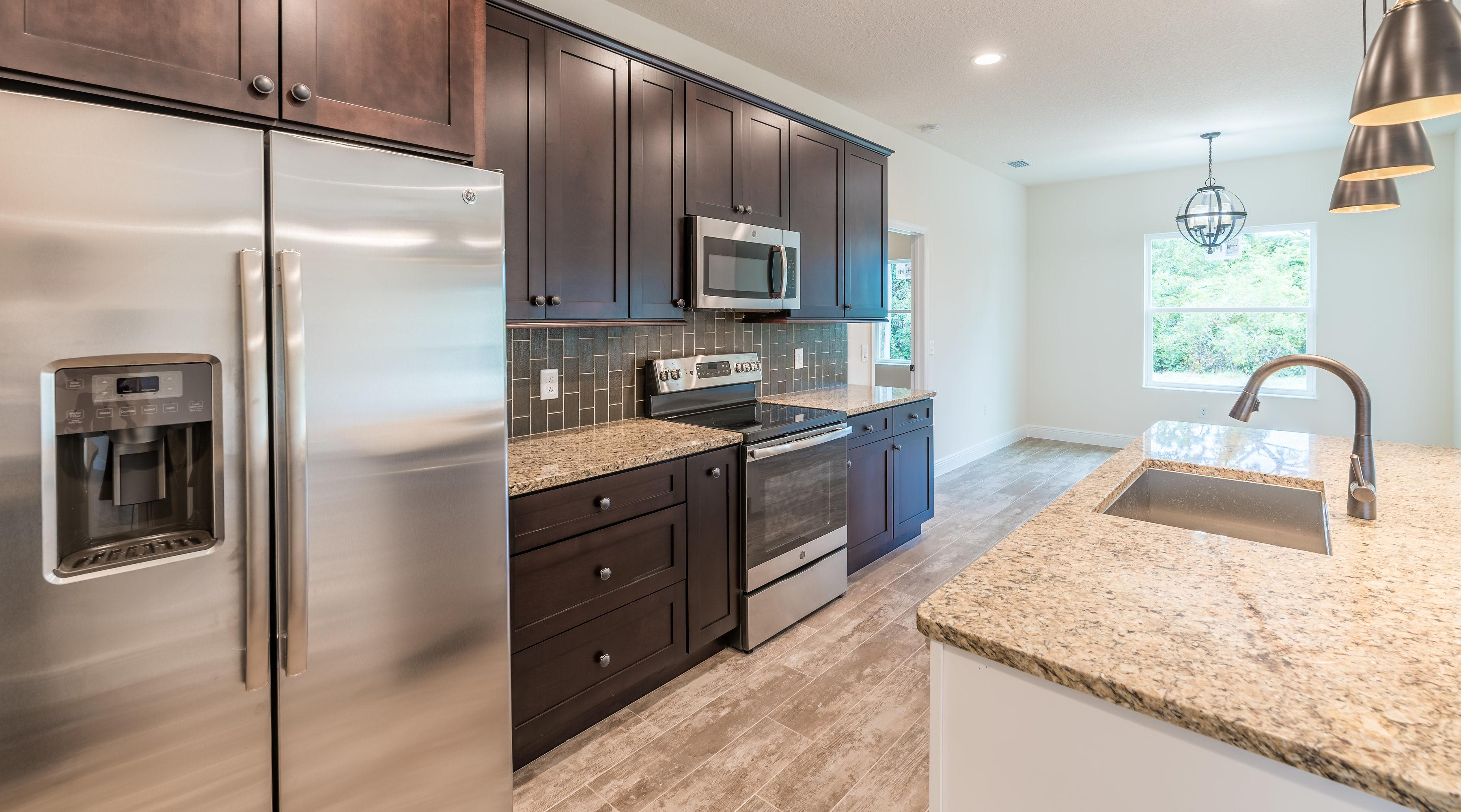 Kitchen featured in the Villa Foscari By Palladio Homes in Fort Myers, FL