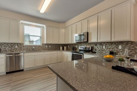 Kitchen-in-Violet at Blackstone Ranch-at-Strasburg New Homes-in-Strasburg