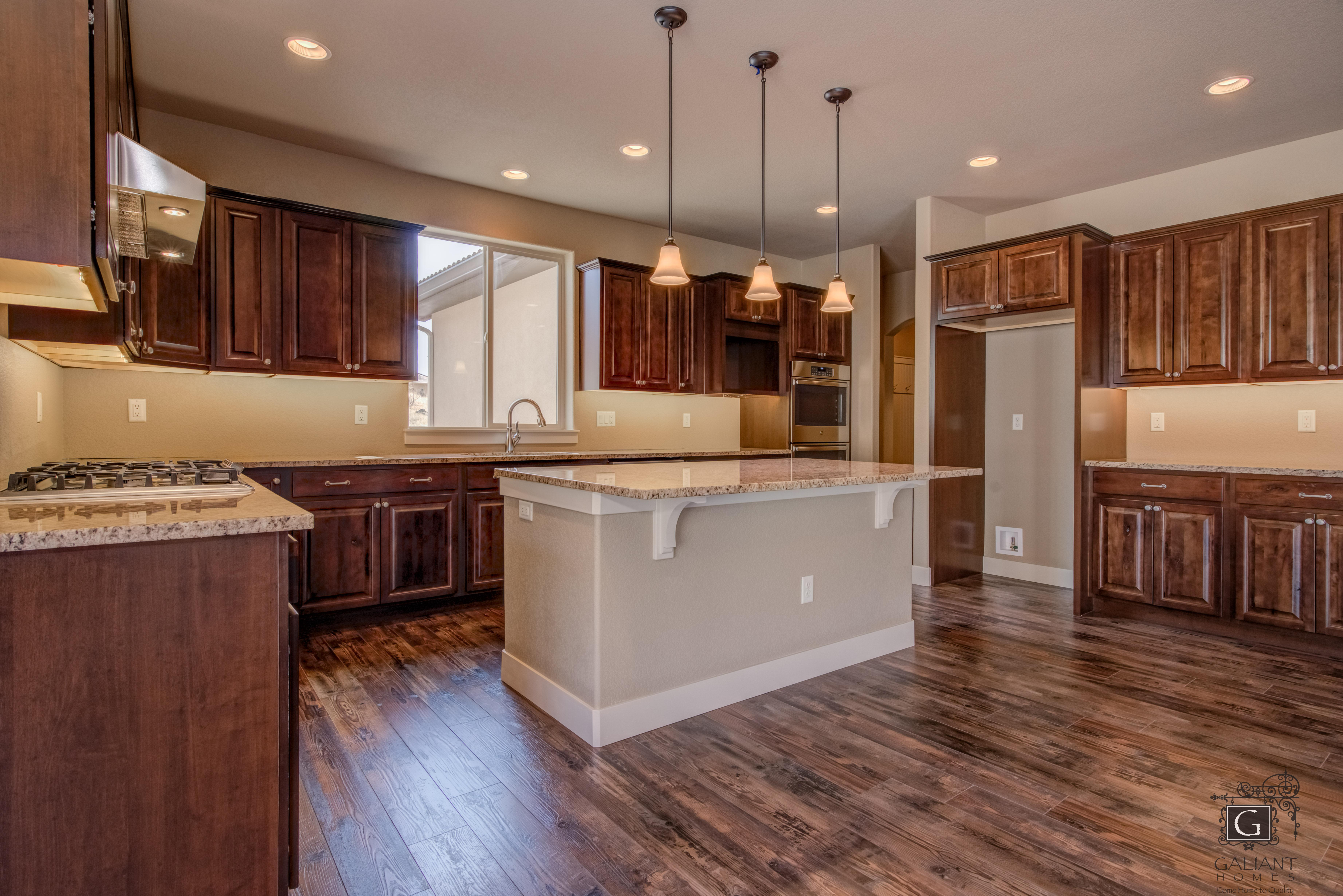 Kitchen featured in the Intrepid (Slab) By Galiant Homes in Colorado Springs, CO