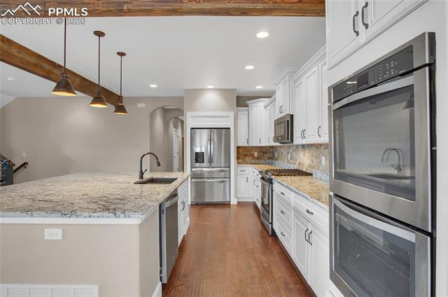 Kitchen featured in the Woodridge By Wildernest in Colorado Springs, CO