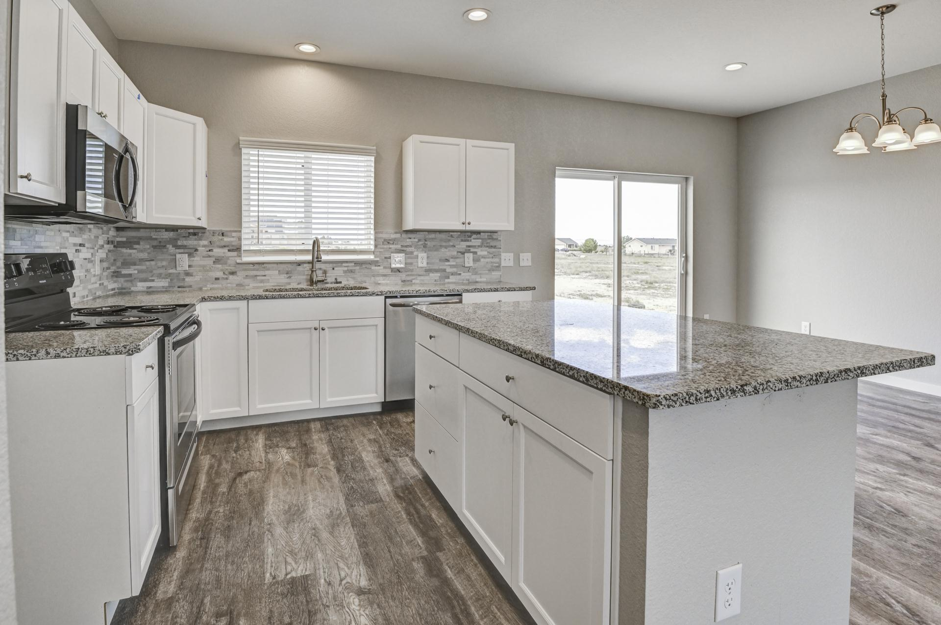 Kitchen featured in the Harmony By Westover Homes in Pueblo, CO