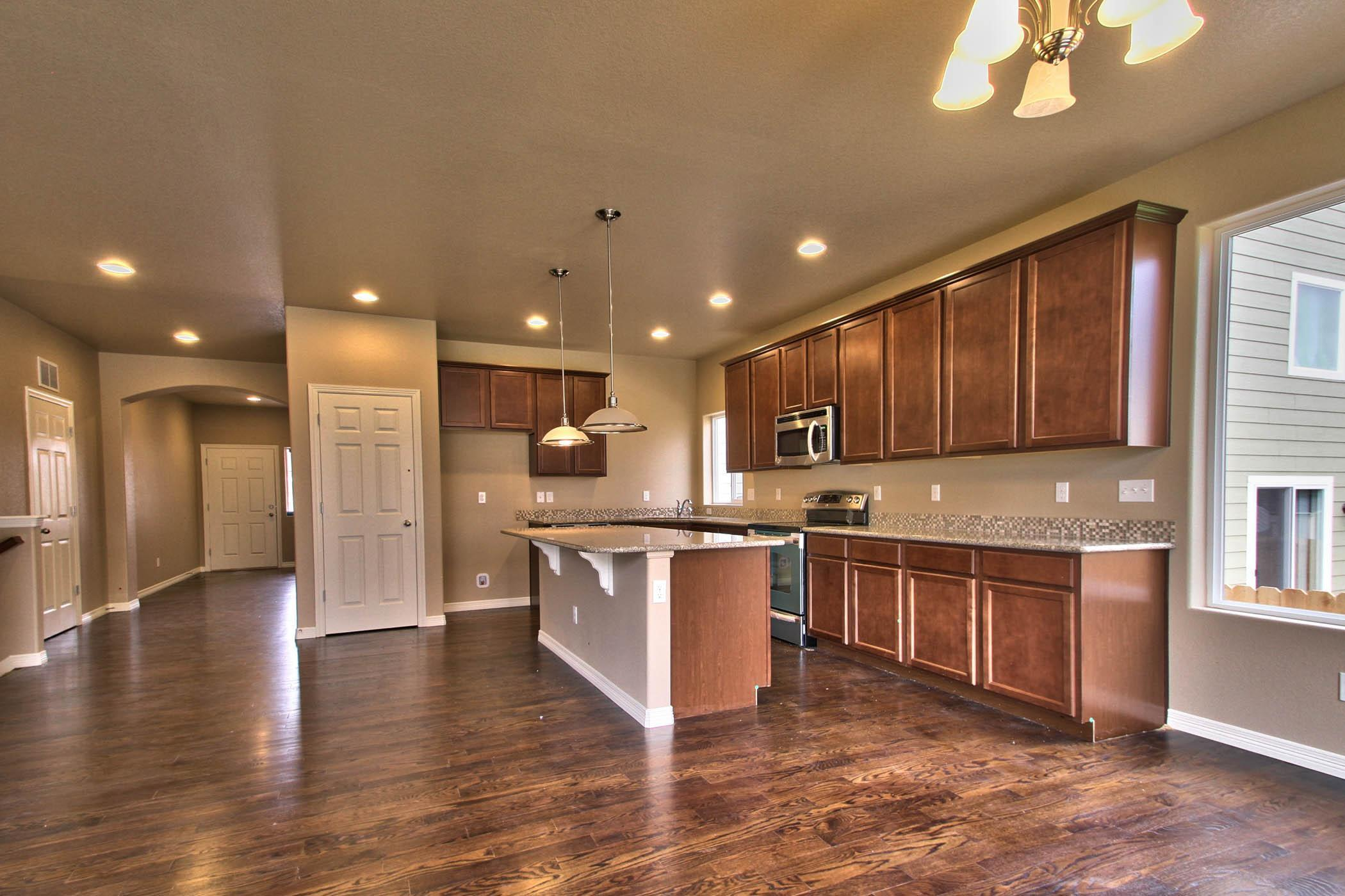Kitchen featured in the Cutler (Slab) By Reunion Homes in Colorado Springs, CO