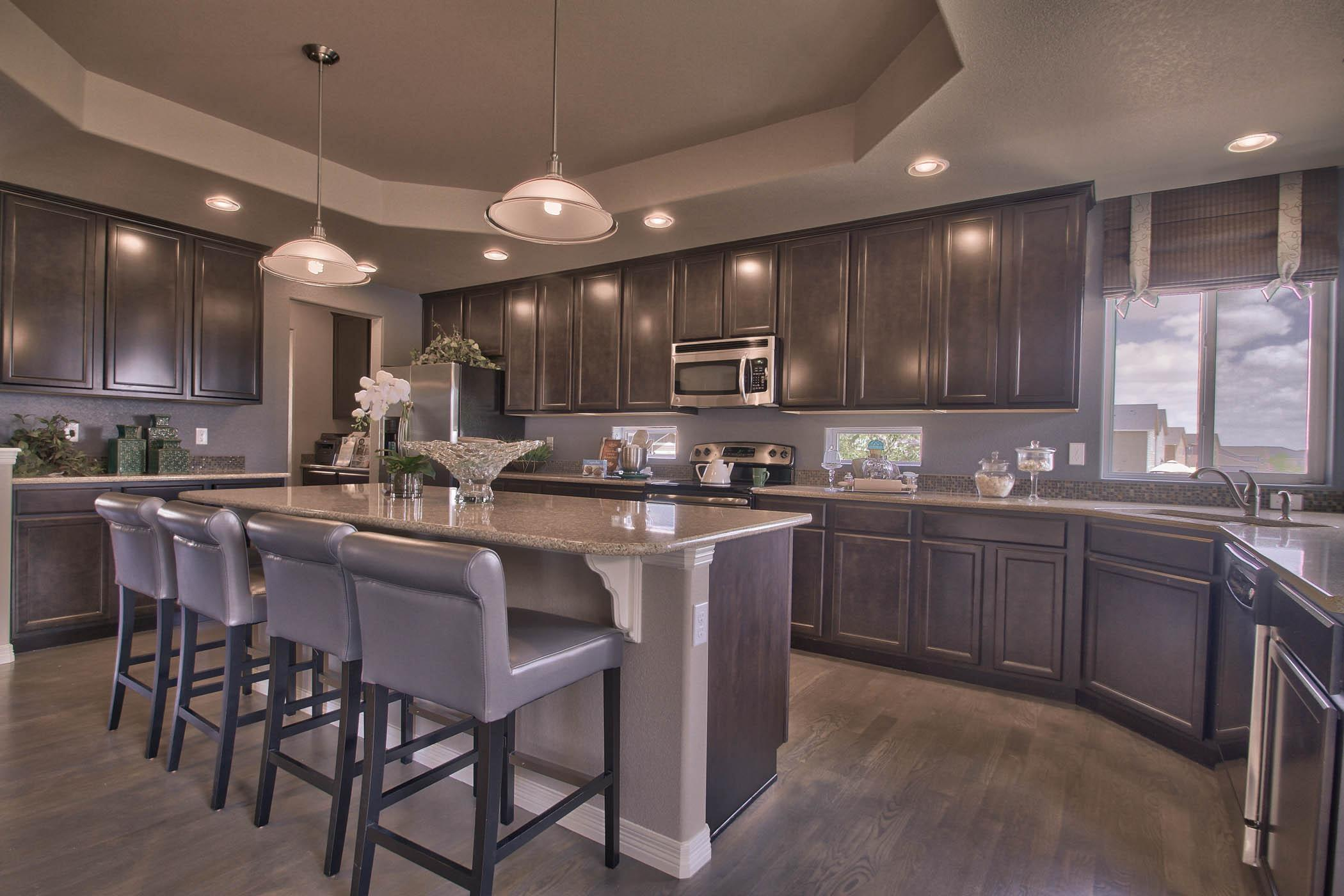 Kitchen featured in The Pikes Peak - Upper Level Master (Slab) By Reunion Homes