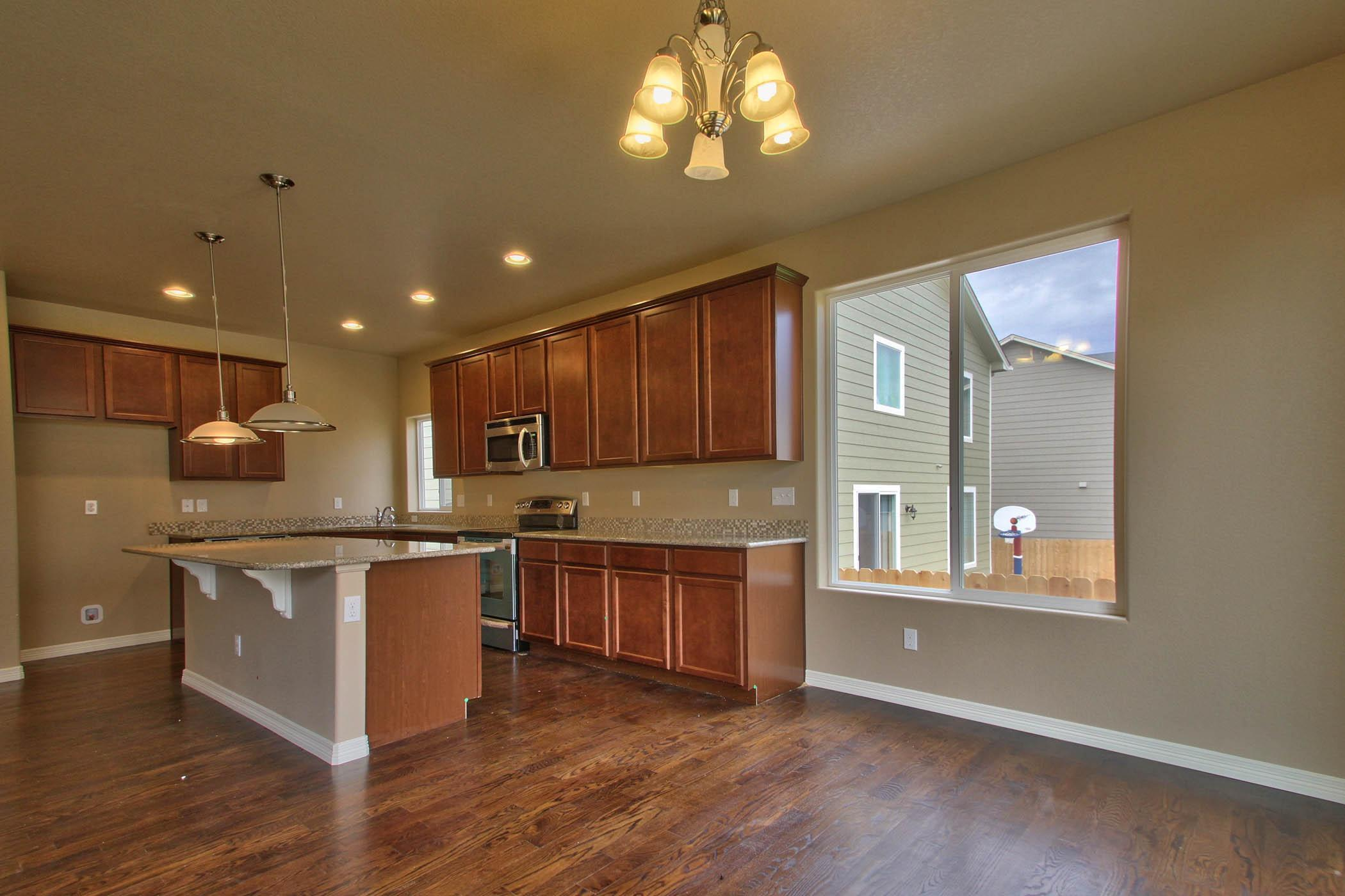 Kitchen featured in the Cutler (Finished Basement) By Reunion Homes in Colorado Springs, CO