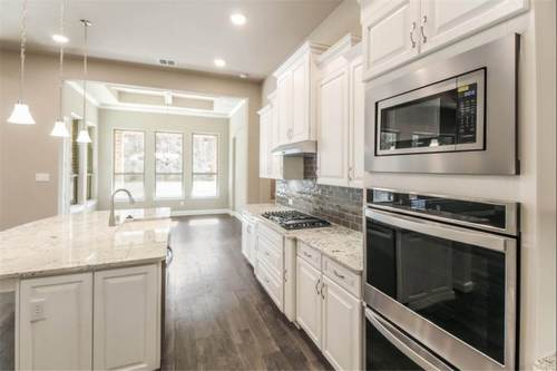 Kitchen-in-Tuscola-at-Wildridge 70' Homesites-in-Oak Point
