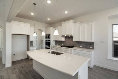 Kitchen-in-Caddo-at-Wildridge 70' Homesites-in-Oak Point