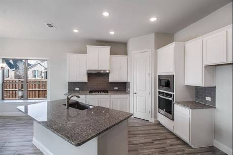 Kitchen-in-Baylor Creek-at-Trinity Falls-in-McKinney