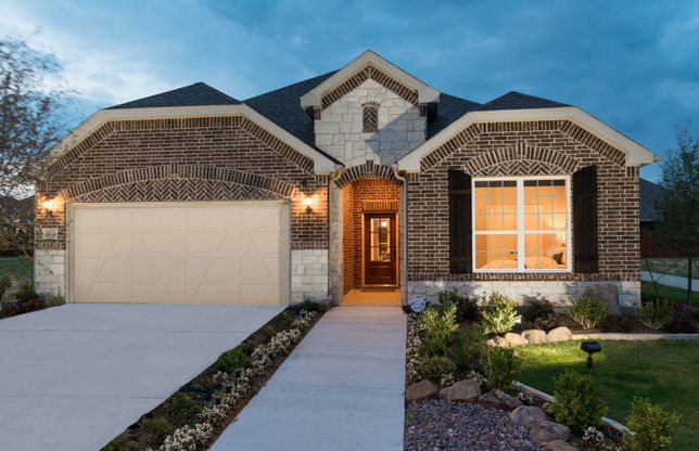 Mooreville:Exterior C with stone accents, black shutters, and 2-car garage with storage space