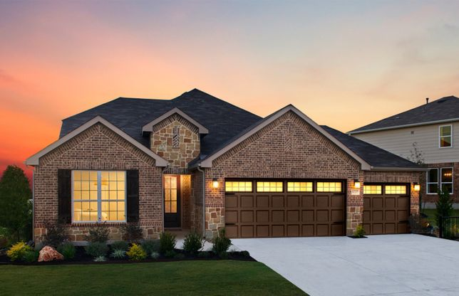 Mooreville:The Mooreville, a two-story home with 3-car garage, shown with Home Exterior B