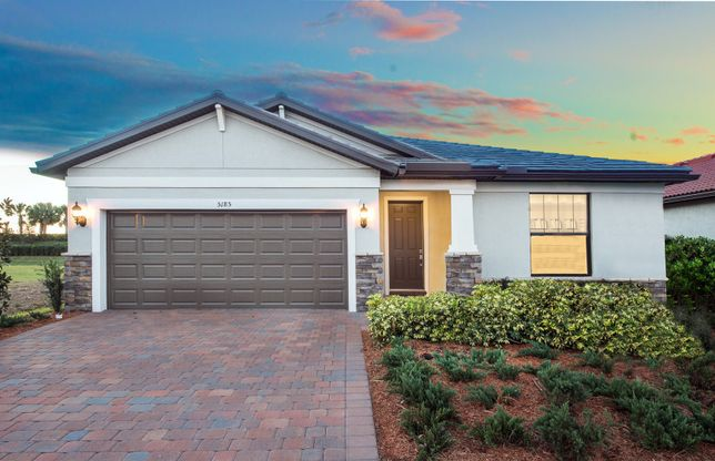 Oasis:The Oasis, a single-story home with a 2 car garage, shown with Home Exterior C2A.