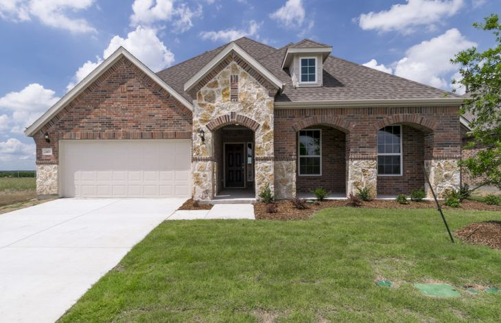 Exterior:Available now - Kennedale plan in Winn Ridge with brick and stone exterior