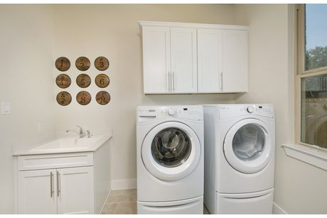 Laundry-in-Hillside-at-Heritage Oaks at Pearson Place-in-Austin