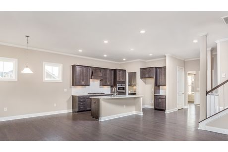 Kitchen-in-The Continental by John Wieland-at-Holding Village-in-Wake Forest