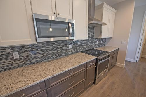 Kitchen-in-Buckley C (Craftsman)-at-Palisades-in-Clermont