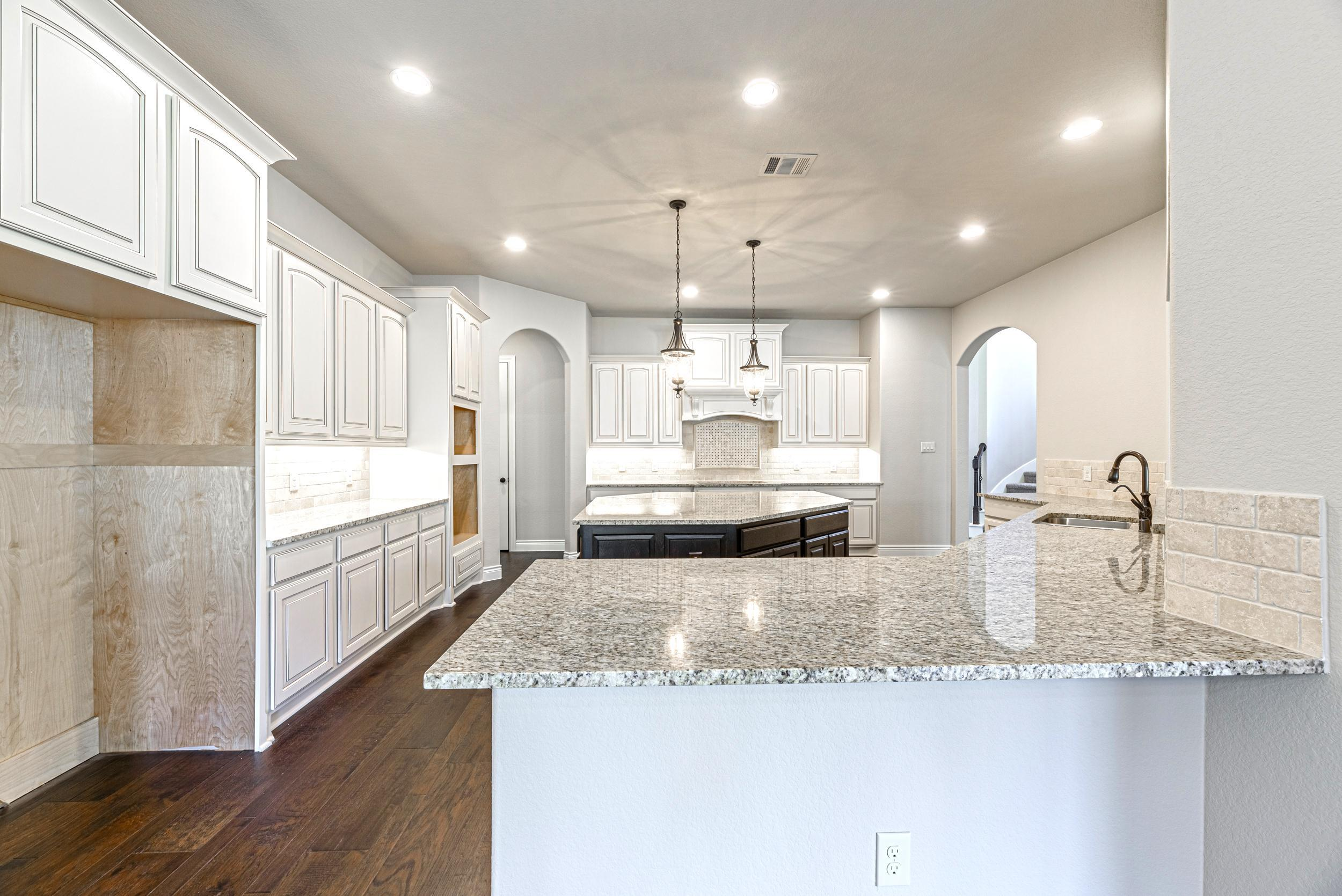 Kitchen featured in the Towne Lake 4195 By Ravenna Homes in Houston, TX