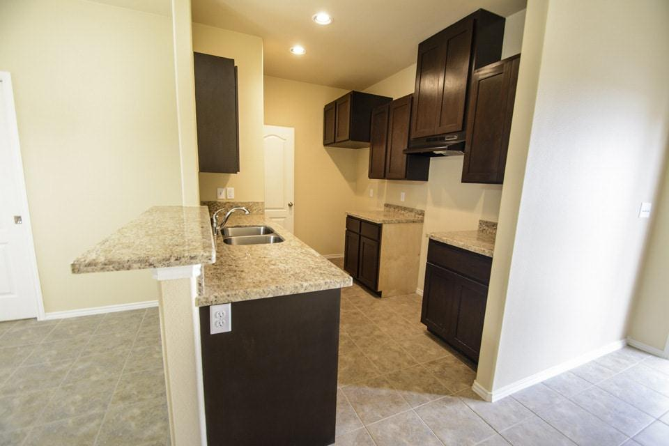 Kitchen featured in the Townhomes 2-Bed By WestWind Homes in Laredo, TX