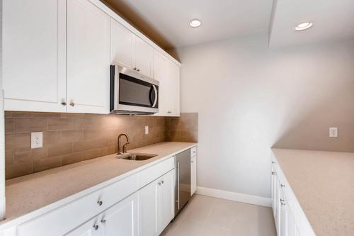Kitchen-in-The Jamestown II-at-Ridge at Harmony Road-in-Windsor