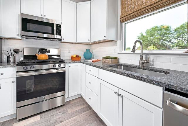 Kitchen featured in the Sylvan at Long Lake Square By Robertson Brothers  in Detroit, MI