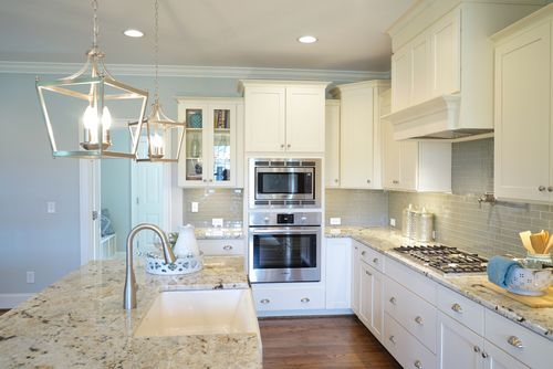 Kitchen-in-The Carolina-at-Ballentine Place-in-Holly Springs