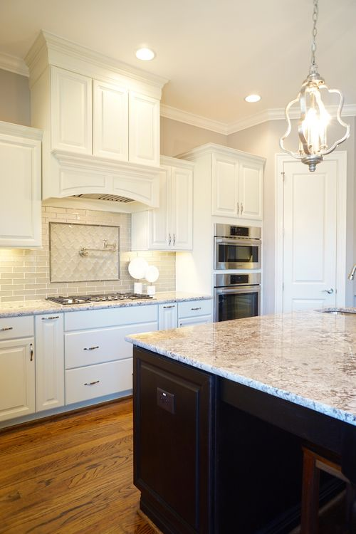 Kitchen-in-The Somerset-at-Ballentine Place-in-Holly Springs