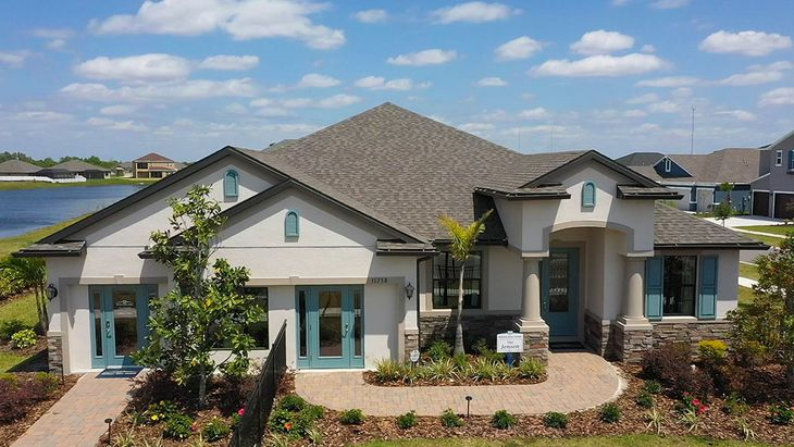 Jensen model home front exterior with lake Barrington at South Fork Riverview FL William Ryan Hom...:Barrington at South Fork - Jensen Model Home - Front Exterior with Lake