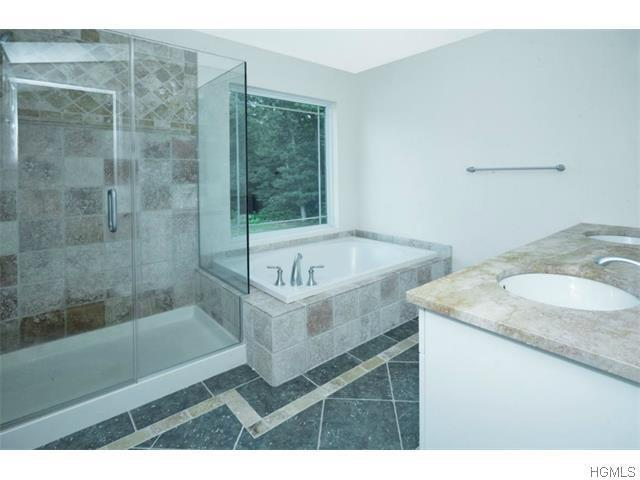 Bathroom featured in the Amherst By Harness Estates  in Orange County, NY