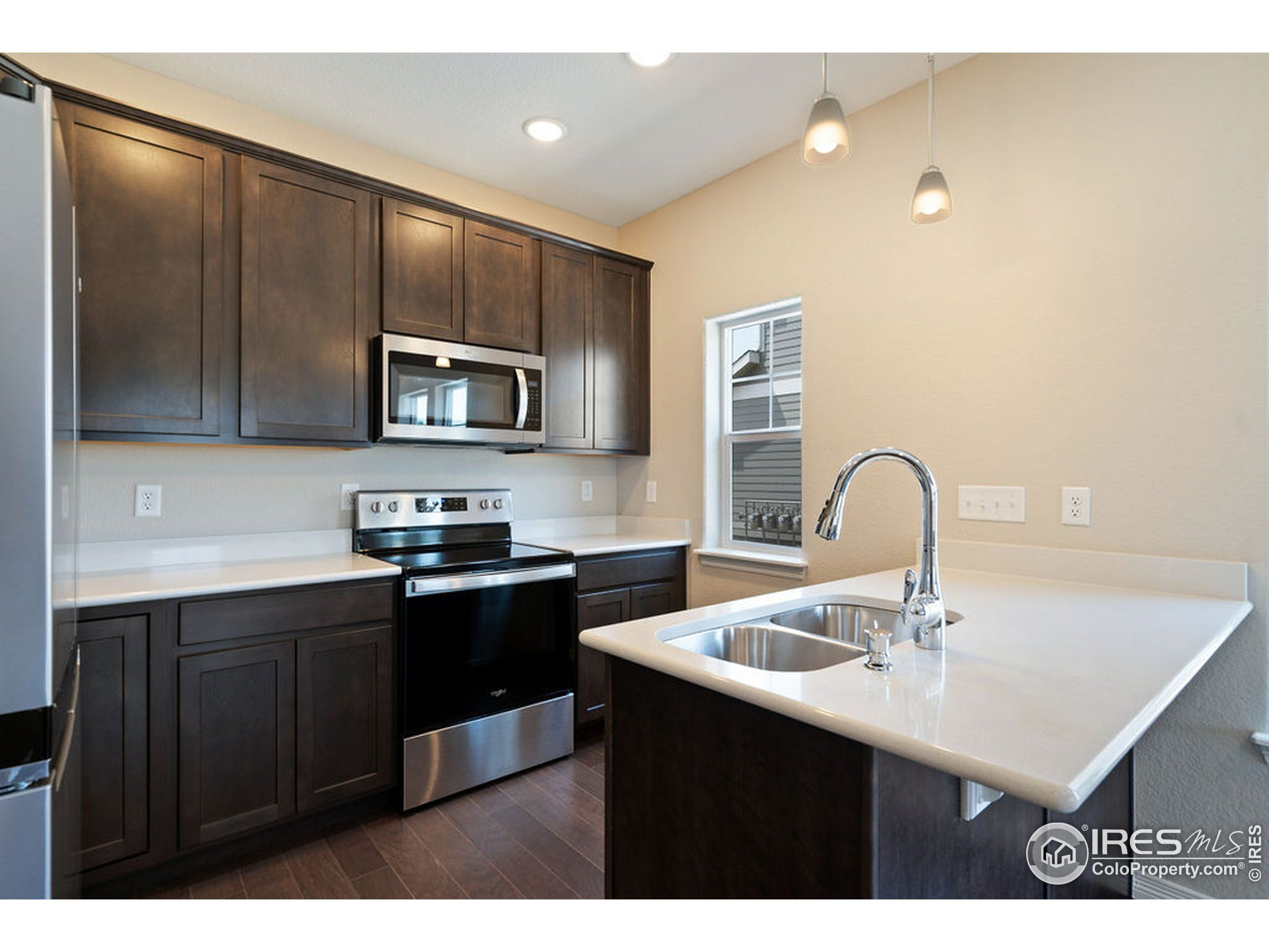 Kitchen featured in the Pine Cone By Tralon Homes LLC in Fort Collins-Loveland, CO