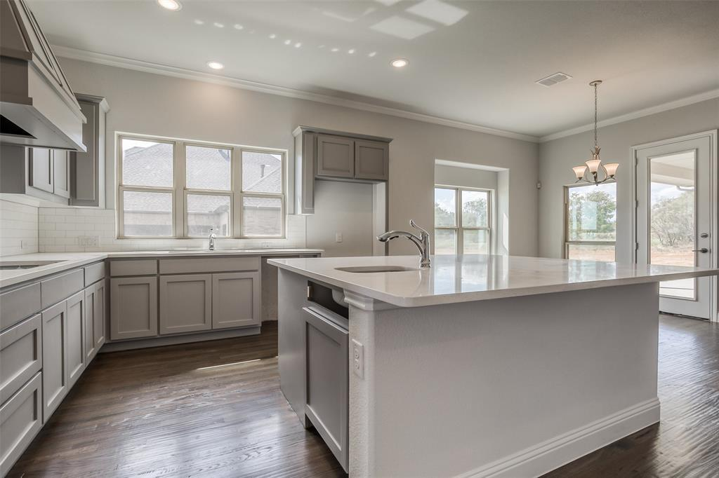 Kitchen featured in the Madrid By Sandlin Homes  in Fort Worth, TX