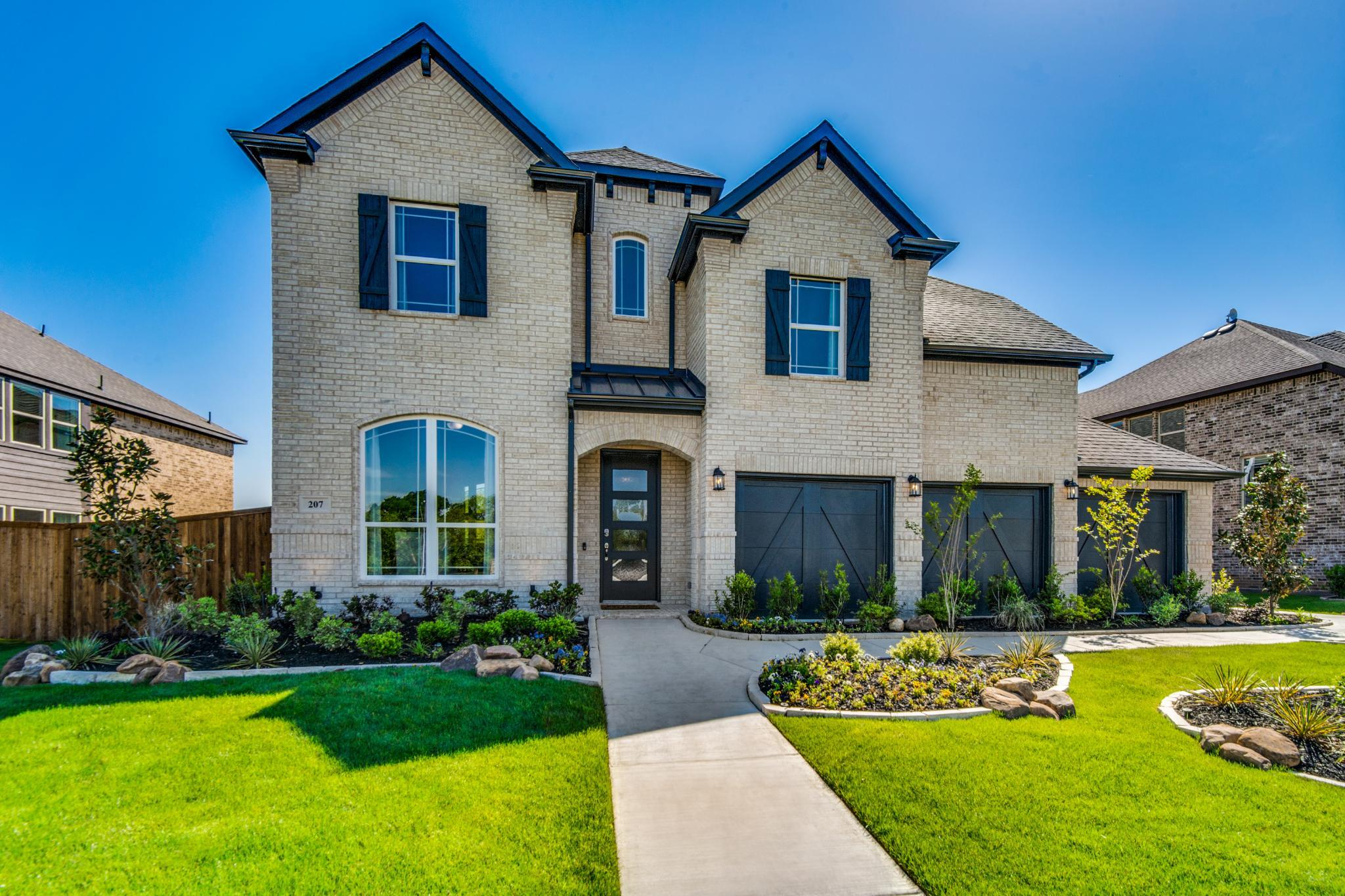 Exterior featured in the Monte Carlo By Sandlin Homes  in Dallas, TX