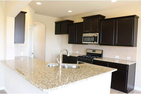 Kitchen-in-Plan 2160 MC-at-Blackhawk-in-Pflugerville