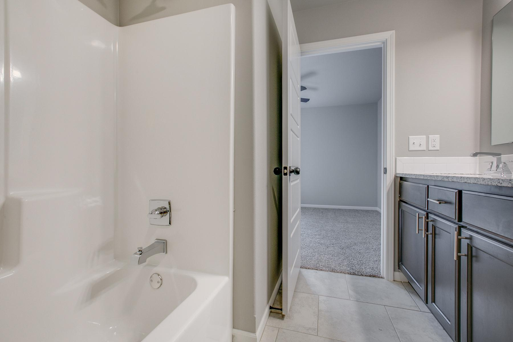 Bathroom featured in the 1400-4 Series By Schuber Mitchell Homes in Fayetteville, AR