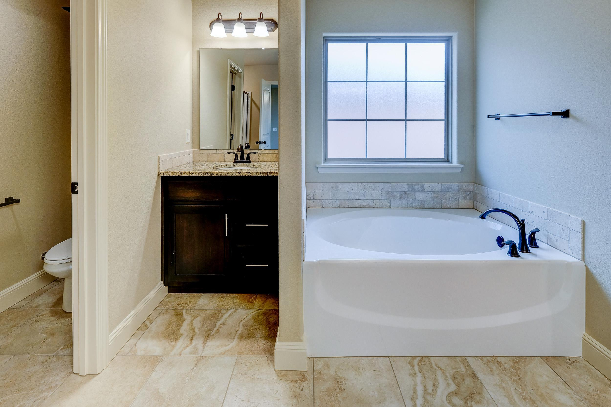 Bathroom featured in the 1650KI Series By Schuber Mitchell Homes in Joplin, MO