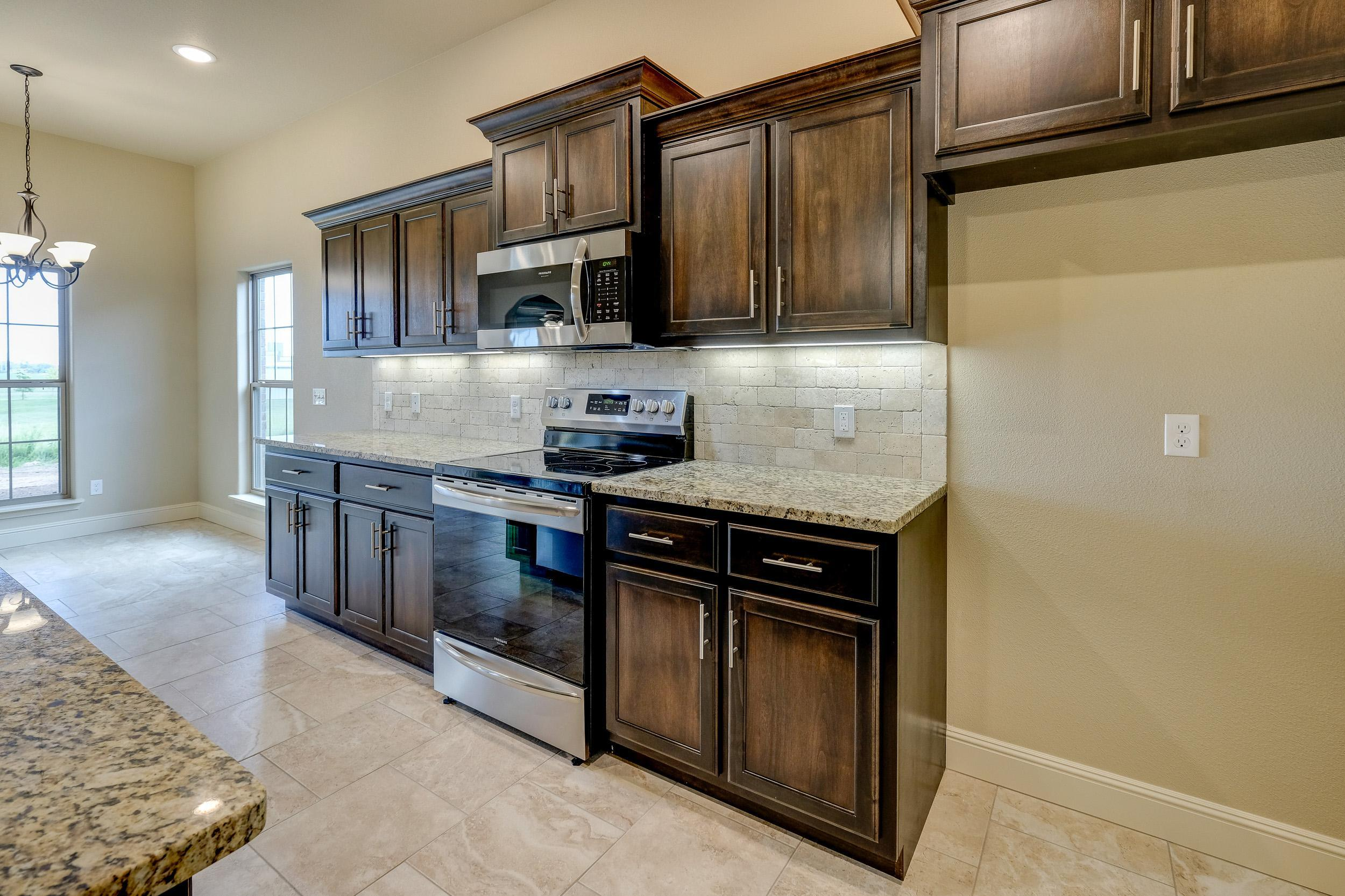 Kitchen featured in the 1650KI Series By Schuber Mitchell Homes in Joplin, MO