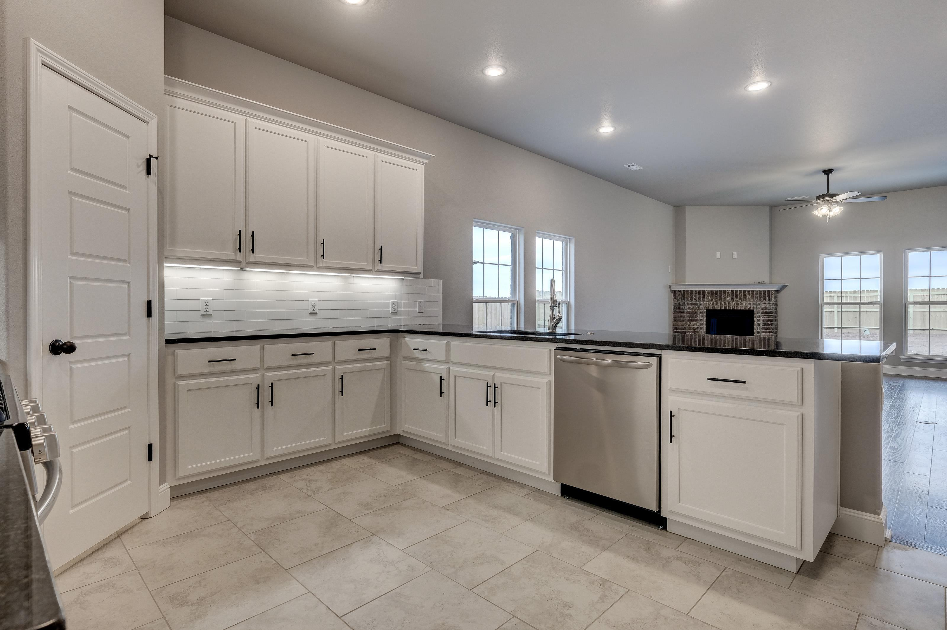 Kitchen featured in the 1950KP Series By Schuber Mitchell Homes in Fayetteville, AR