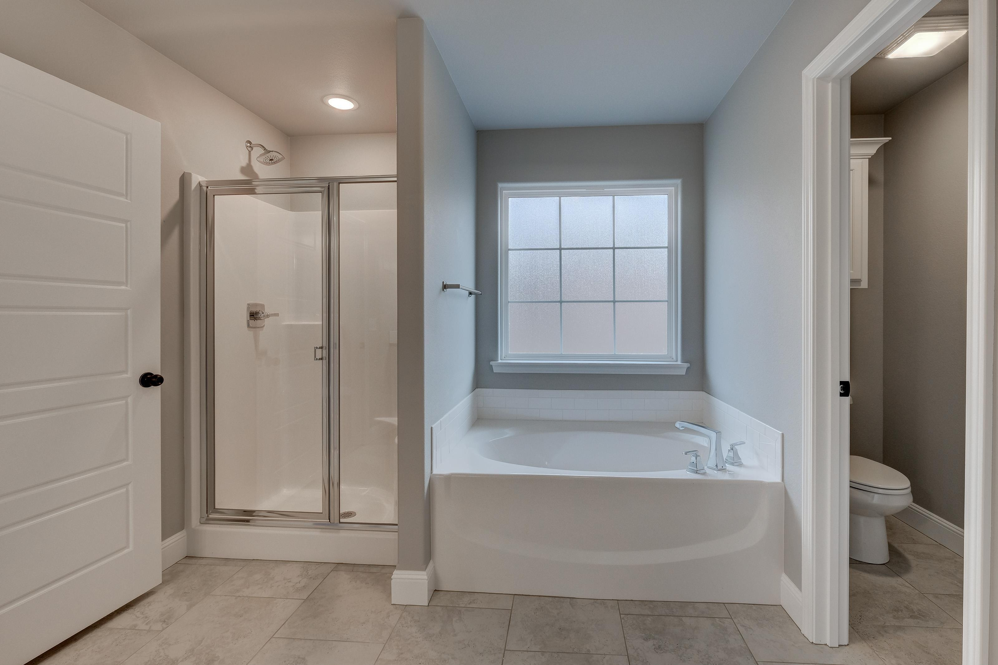 Bathroom featured in the 1950KP Series By Schuber Mitchell Homes in Fayetteville, AR