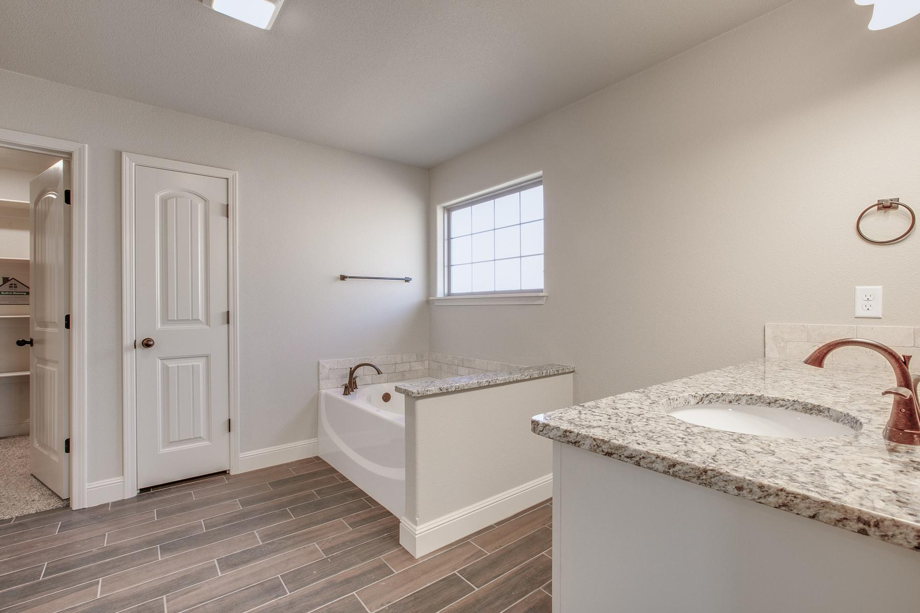 Bathroom featured in the 2300KI Series By Schuber Mitchell Homes in Fayetteville, AR