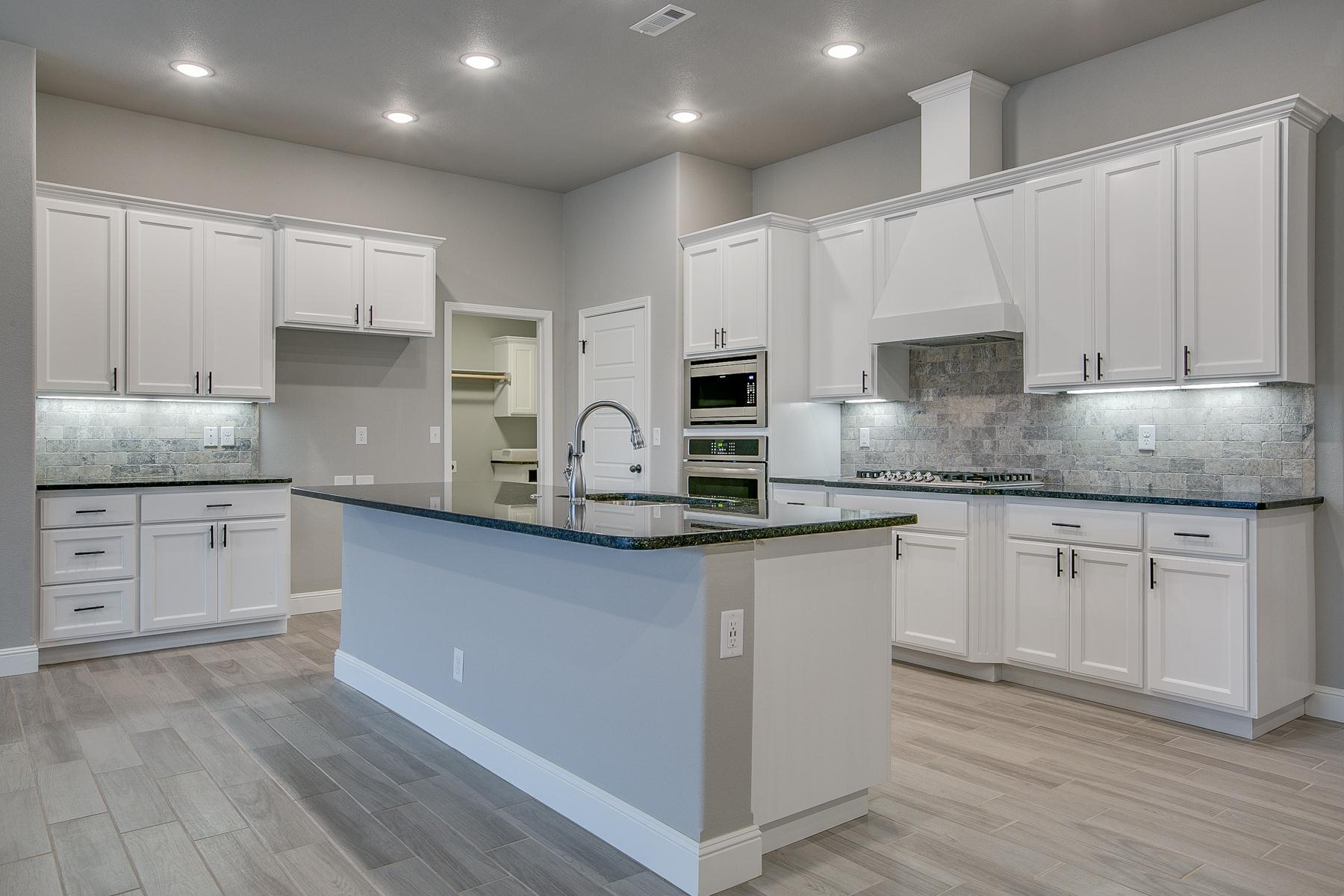 Kitchen featured in the 2500 Series By Schuber Mitchell Homes in Fayetteville, AR
