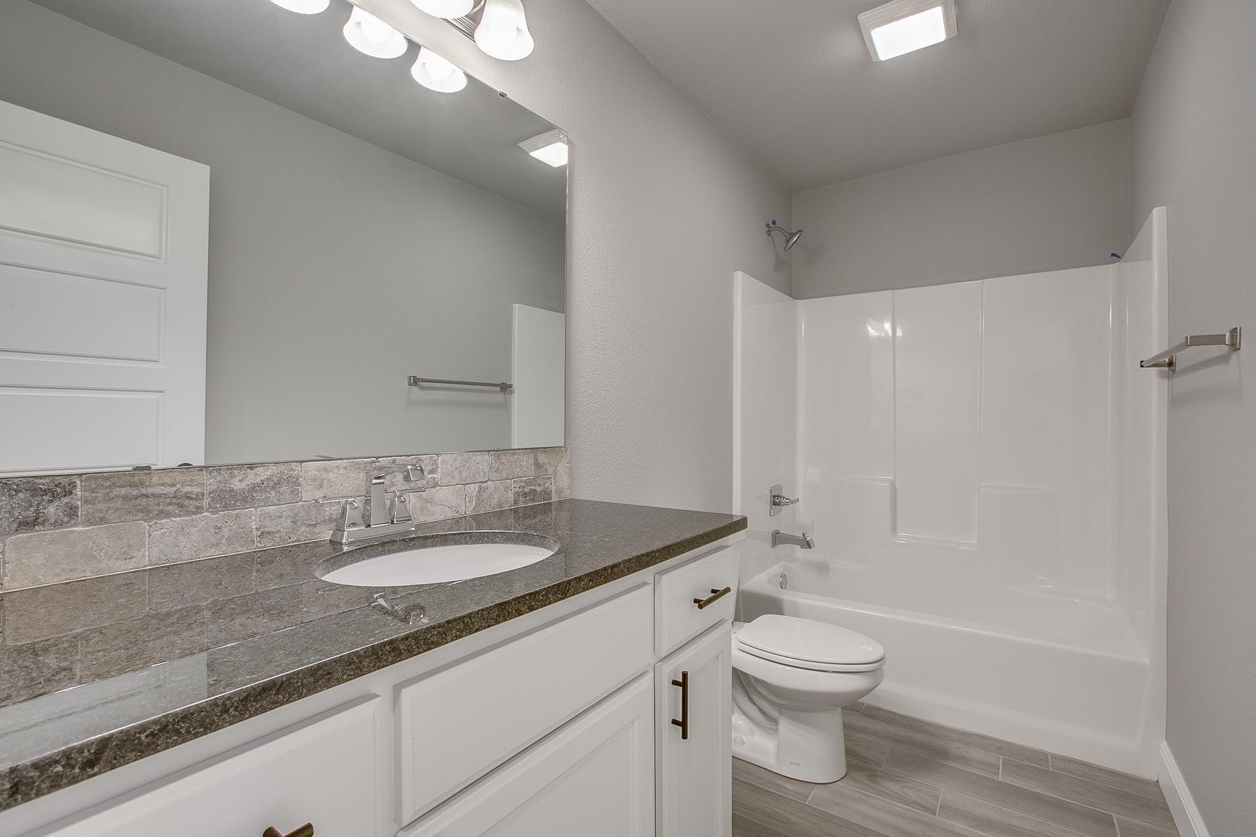 Bathroom featured in the 2500 Series By Schuber Mitchell Homes in Fayetteville, AR
