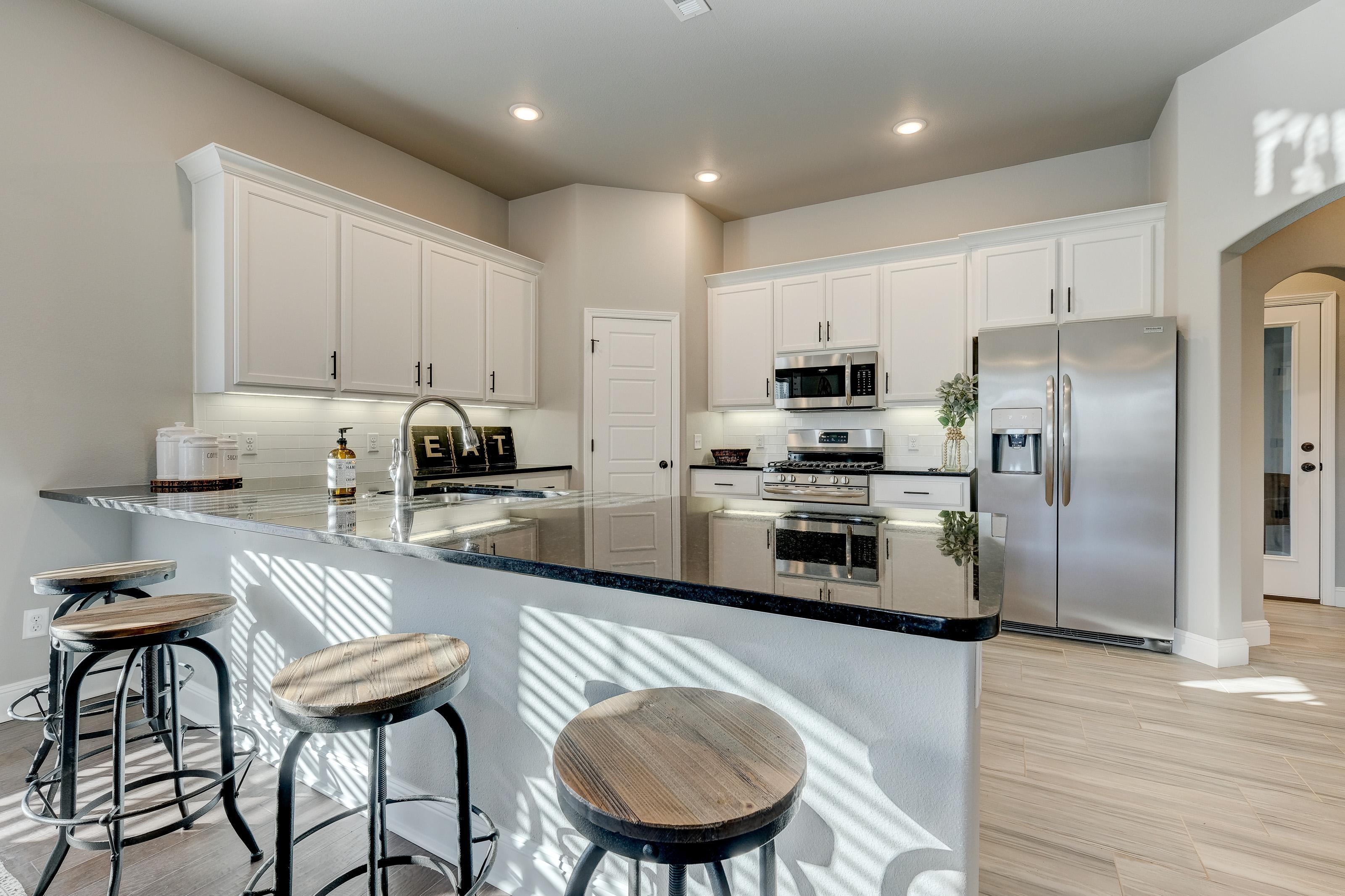 Kitchen featured in the 2050KP Series By Schuber Mitchell Homes in Fayetteville, AR