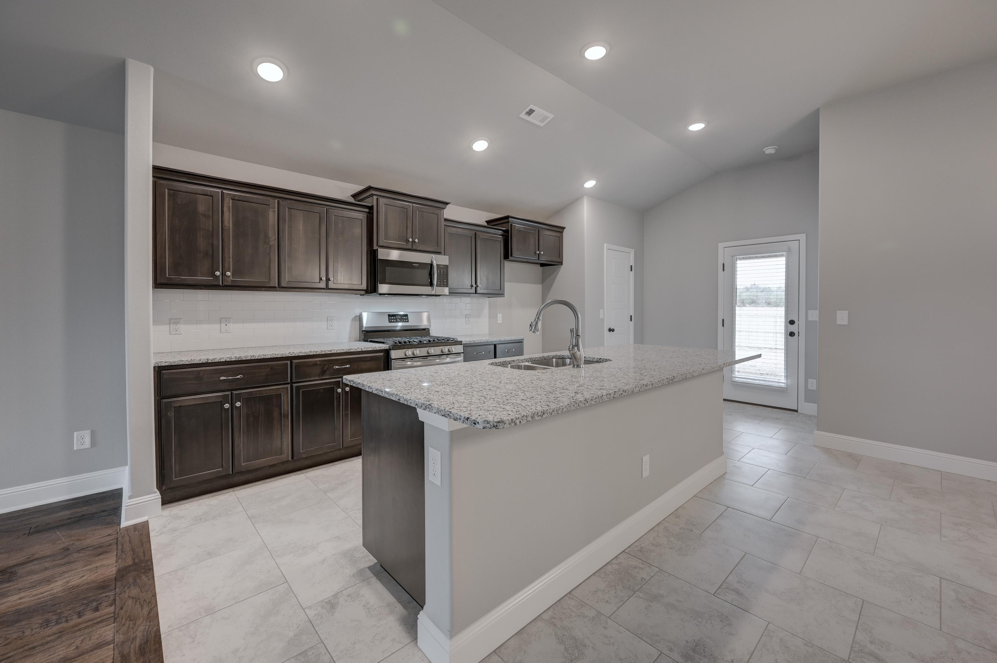 Kitchen featured in the 1550KB Series By Schuber Mitchell Homes in Fayetteville, AR