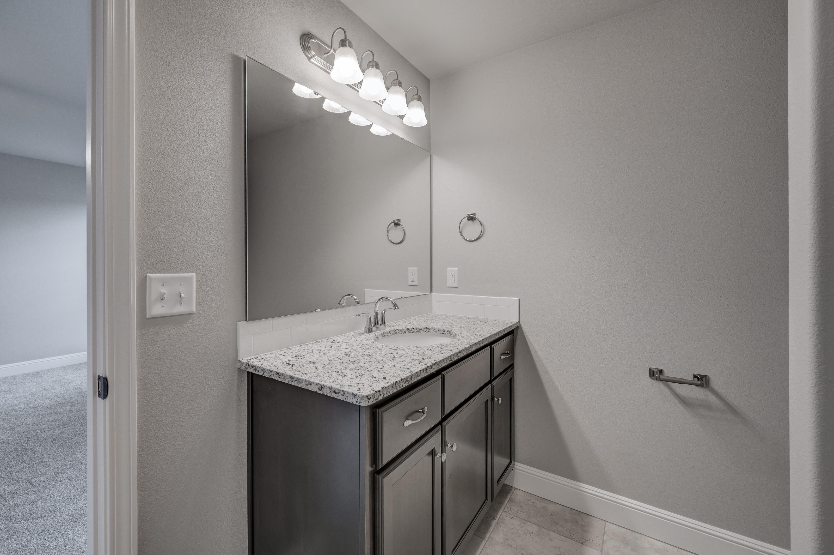 Bathroom featured in the 1550KB Series By Schuber Mitchell Homes in Fayetteville, AR