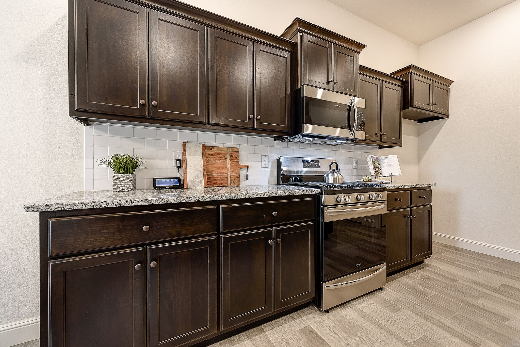 Kitchen featured in the 1650KI Series By Schuber Mitchell Homes in Fayetteville, AR