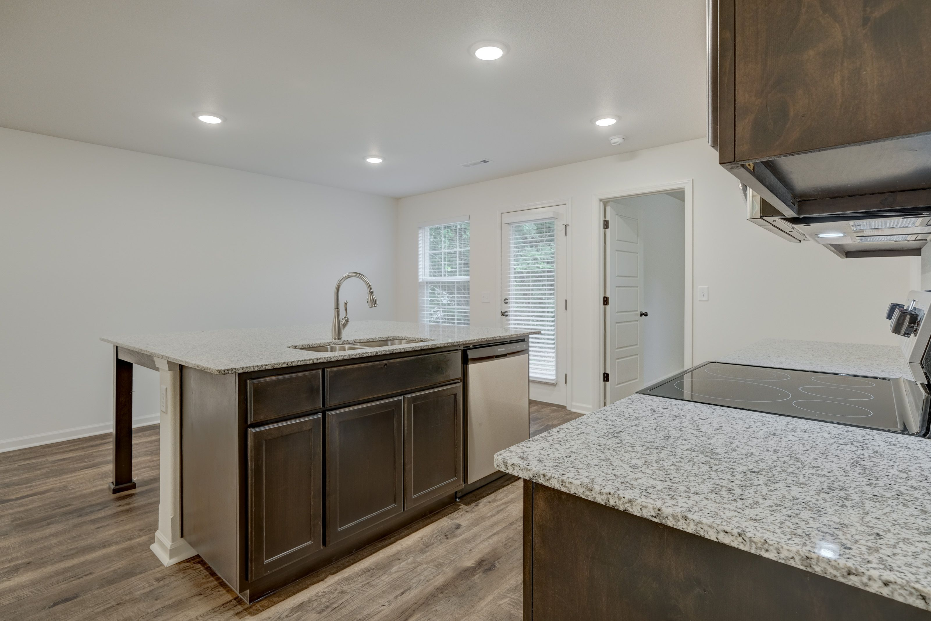 Kitchen featured in the 1100C-KI Series By Schuber Mitchell Homes in Fayetteville, AR