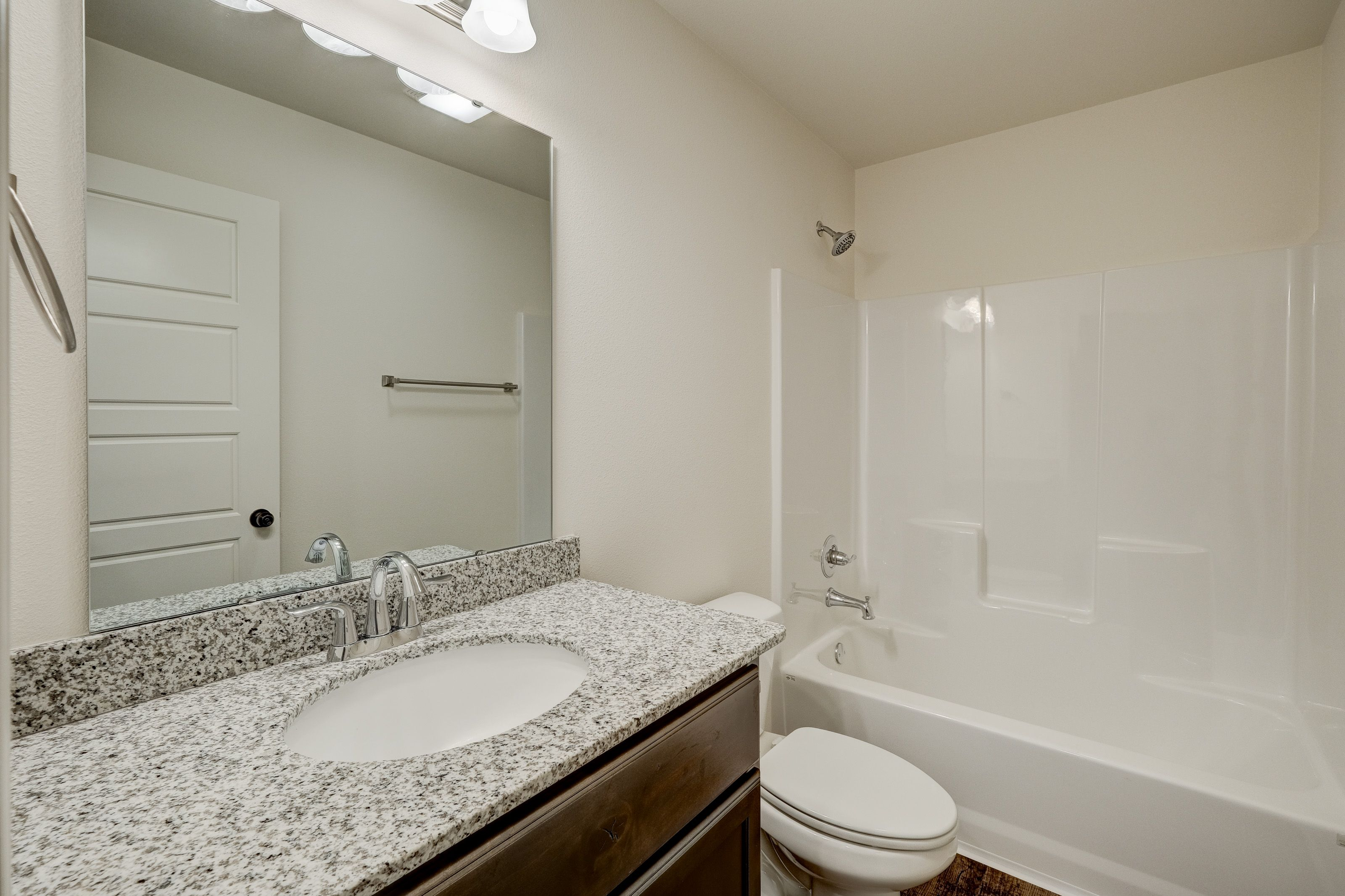 Bathroom featured in the 1100C-KI Series By Schuber Mitchell Homes in Fayetteville, AR